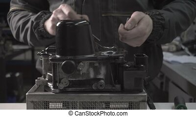 The mechanic makes dismantling of an automobile automatic...