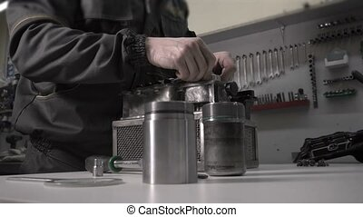 The mechanic makes replacement of the hydroaccumulator in...