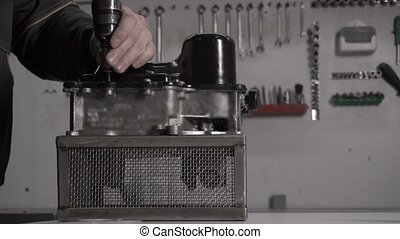 The mechanic performs the assembly of a modern automatic...