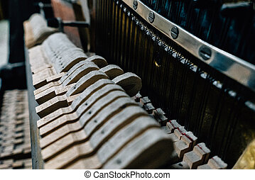 the mechanism of an old piano