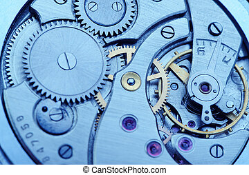 The mechanism of analog hours - blue tone. A photo close up