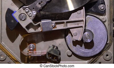 The mechanism of the old hard drive.