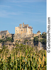 The medieval Chateau de Beynac rising on a limestone cliff ...