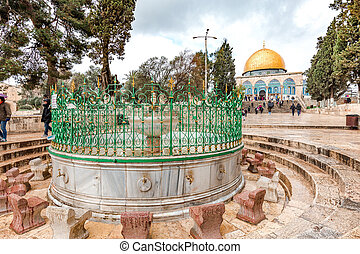 The medieval public Al-Aqsa Fountain with the golden cupola of the Dome of the Rock on the background, Jerusalem, Israel.