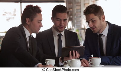 The meeting of three business people