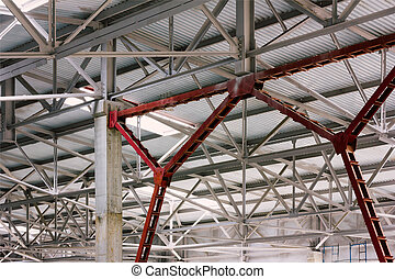 The metal frame of the production facilities of the roof
