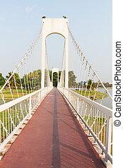 The metal rope bridge in the park