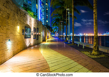 The Miami River Waterfront at night, in downtown Miami,...