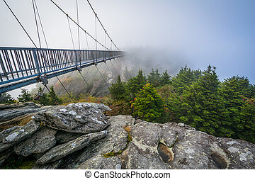 The Mile High Swinging Bridge in fog, at Grandfather Mountain, North Carolina.