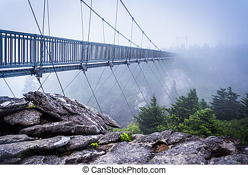 The Mile-High Swinging Bridge in fog, at Grandfather Mountain, North Carolina.