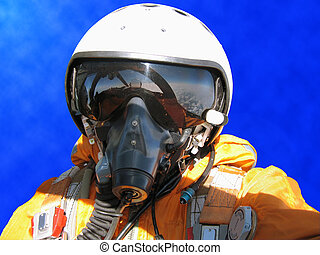 The military pilot in the plane in a helmet in dark blue ...