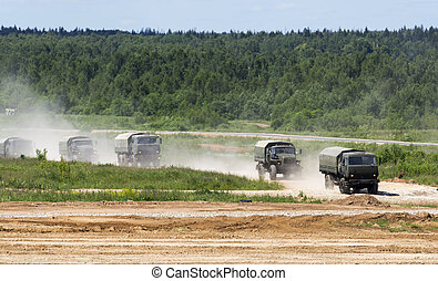 military trucks go on a dirt road