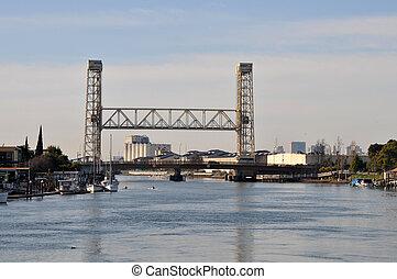 The Miller-Sweeny Drawbridge and Fruitvale Avenue Railroad Bridge over Oakland Estuary, connecting Oakland and Alameda, California