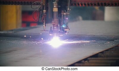 The milling machine cuts metal and spews a lot of sparks