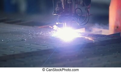 The milling machine processes a metal surface, scattering a lot of sparks