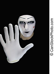 The mime isolated on a black background.