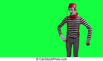 The mime pulls something on the rop - The boy mime against a...