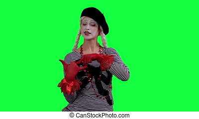 The mime talks on cell phone - The girl mime against a green...