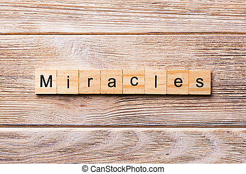 miracles word written on wood block. miracles text on wooden table for your desing, concept