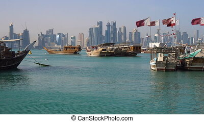 The mix of Ages. View on Doha Modern City Skyline. Day Shot,...