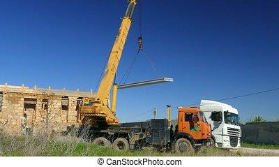 The mobile crane moves the concrete slab