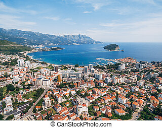 The modern city of Budva, from a bird's-eye view, aerial photo from a drone.