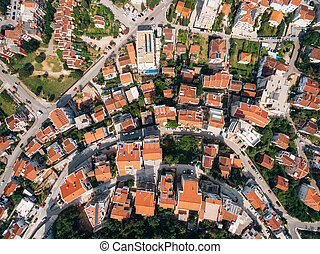 The modern city of Budva, from a bird's-eye view, aerial photo from a drone, top view.