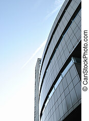 The modern edifice is against morning sky background. The...