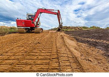 The modern excavator performs excavation work on the sand ...