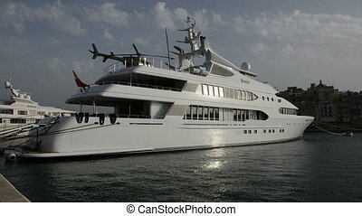 The modern yacht with helicopter