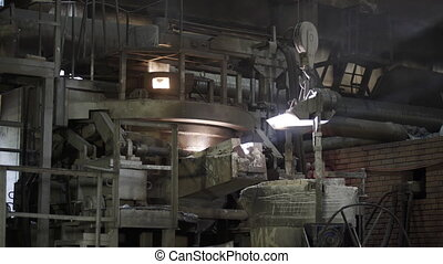 The molten metal in modern induction furnace. Casting liquid metal. Molten metal melted in furnace at metallurgical plant. Iron and Steel Works. Converter plant. Smelting of metal.