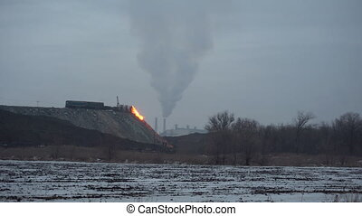 The molten slag in a metallurgical plant - Pour the molten...