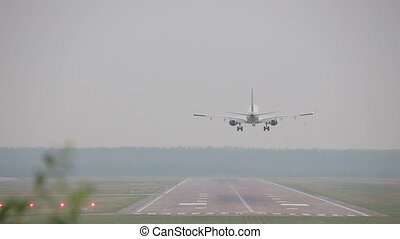 the moment of landing the plane and landing on take-off runway landing air strip