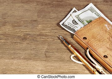 The money, vintage notebook  to trip and gold pen