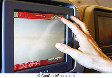 The monitor in interior of the plane