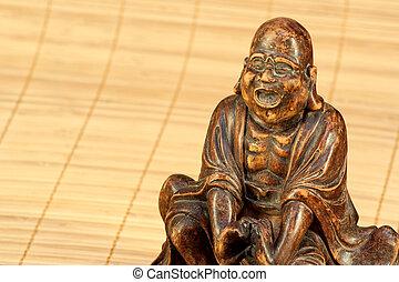 The monk saying a prayer