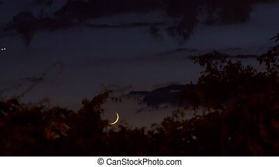 The Moon Down. Nice crescent moon through passing clouds. High definition,