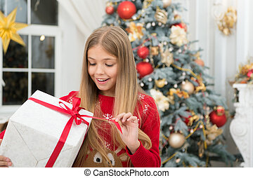 The morning before Xmas. Little girl. Happy new year. Winter. xmas online shopping. Family holiday. Christmas tree and presents. Child enjoy the holiday. Great gift