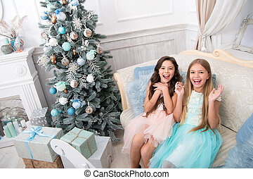 The morning before Xmas. Our home. Little girls. Happy new year. Winter. xmas online shopping. Family holiday. Christmas tree and presents. Child enjoy the holiday