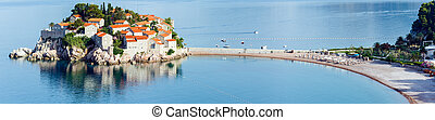 The morning view of Sveti Stefan sea islet with beach and town-hotel (Montenegro, 6 kilometres southeast of Budva)