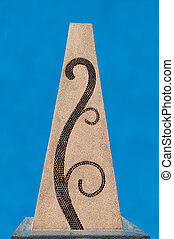 The Mosaic Spiral on concrete block isolated on blue background