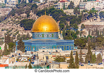 The roofs of Jerusalem with sunset. The golden dome of the mosque of Omar. The concept of historical, religious, pilgrim and photo tourism