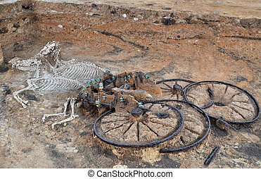 Ancient thracian chariot with two horses, as a part of nobel man's burial from mound in the village of Karanovo, Bulgaria. It is from 1st century, which makes it the most ancient thracian burial found so far.