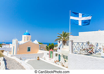The most famous church on Santorini Island,Crete, Greece. Bell tower and cupolas of classical orthodox Greek church with view of Mediterranean sea and Spinalonga island