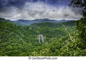 The most famous Khlonglan waterfall in deep forest top view in mountains with cloud and sky.