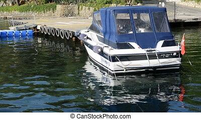 The motor boat near pier