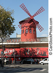 The Moulin Rougein Paris, France. Moulin Rouge is the most famous Parisian cabaret and it created the modern can-can dance.
