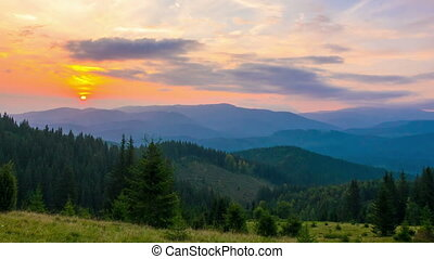 The Mountain Forest on Background of Sunset. Dramatic Sunset...