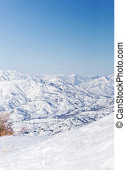 The mountain resort of Beldersay, Uzbekistan. Panorama of the mountains from the pass in winter