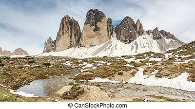 The mountain river against the sharp mountains in Dolomites.